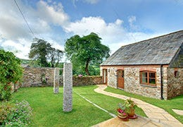 Cottage with garden and stone wall