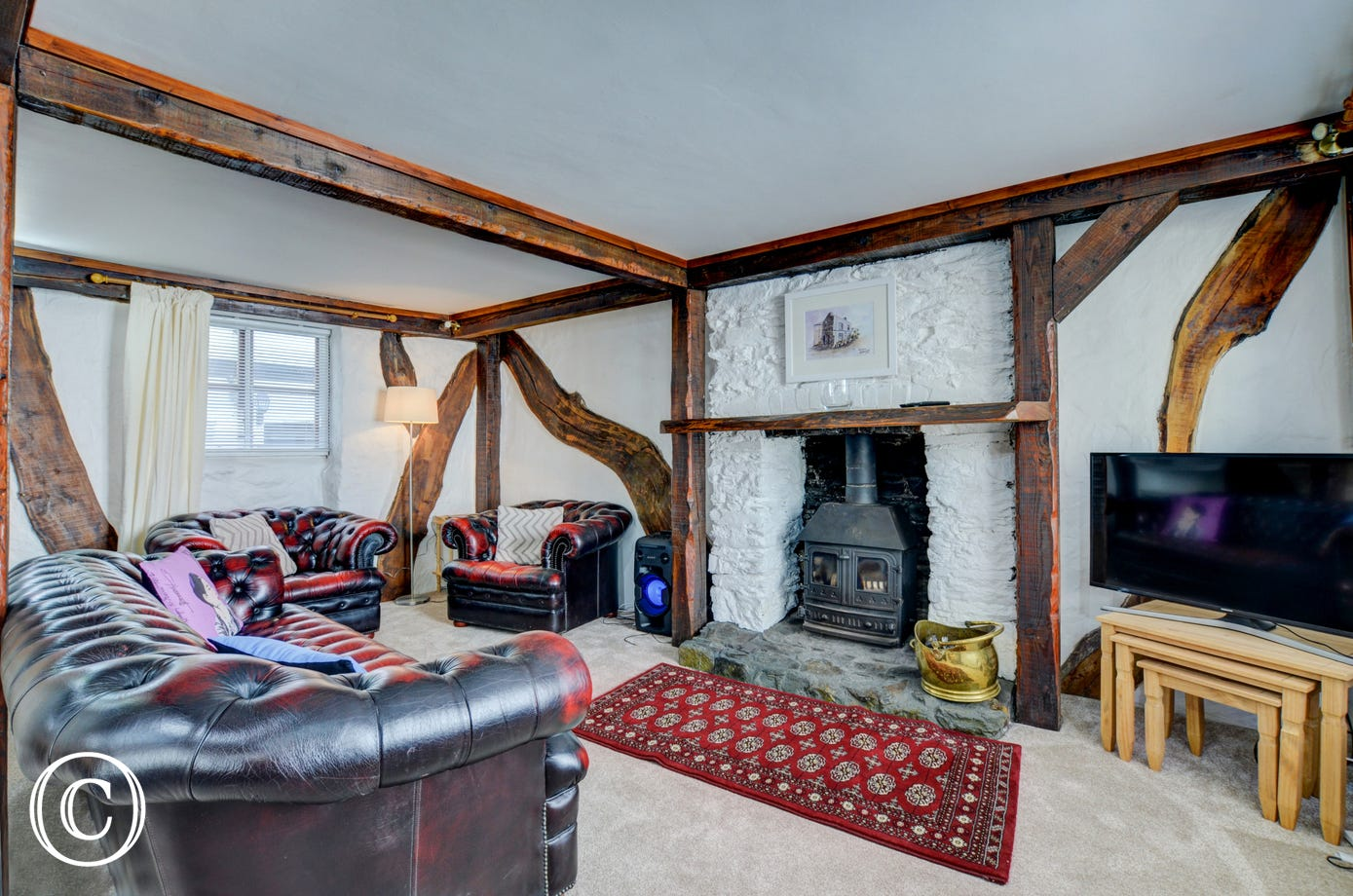 Sitting Room with woodburner and exposed beams