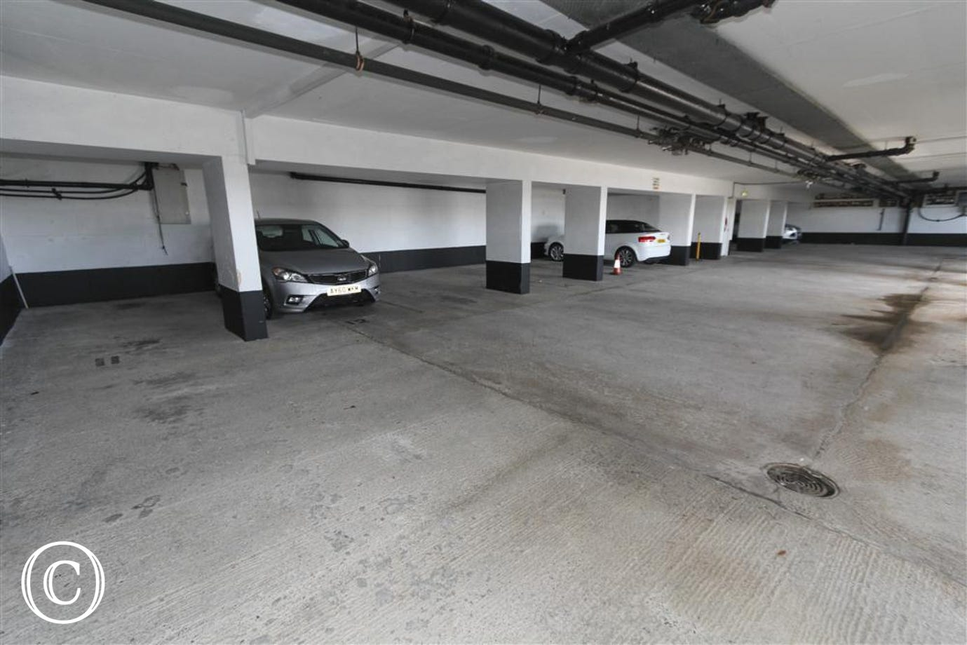 Parking Space, second from left (with silver car in space).