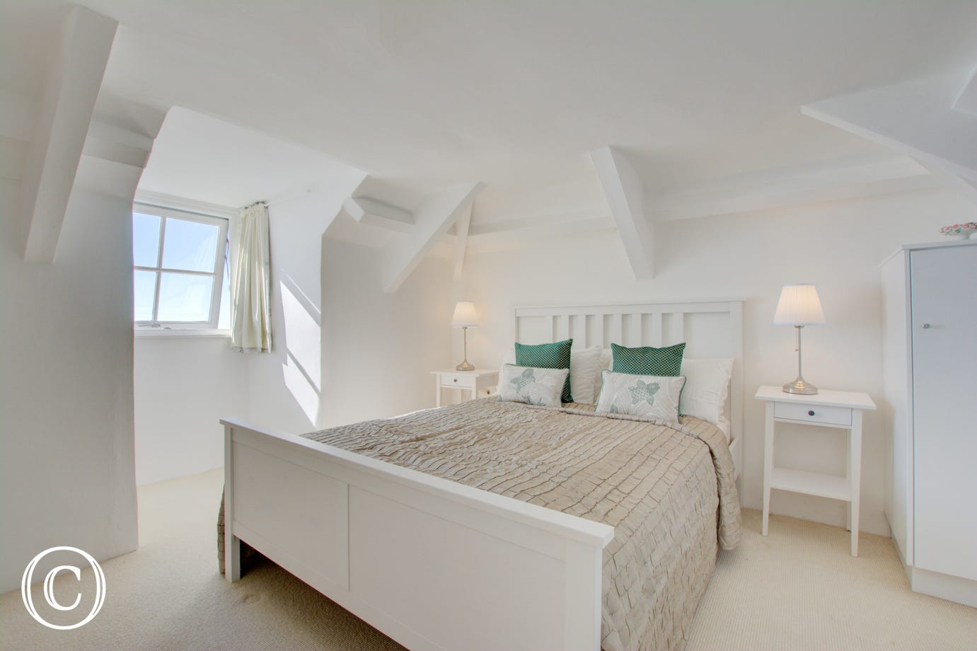 Bedroom 5 on top floor with sea views