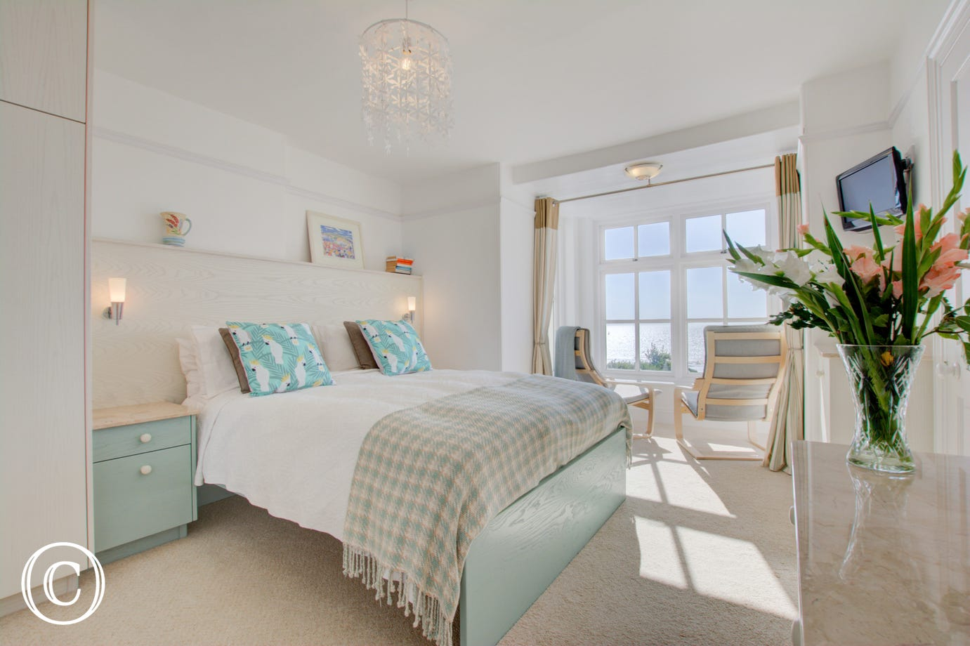 Bedroom 1 with seating area to enjoy the outstanding views