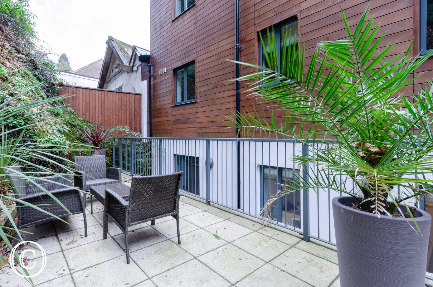 Shared rear terrace with outdoor seating