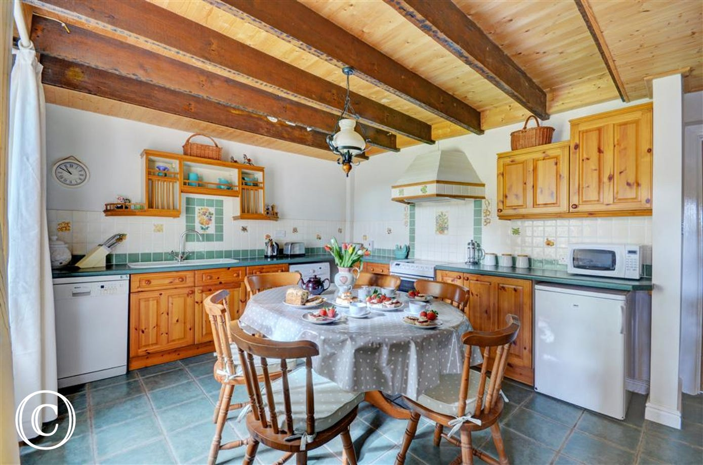 Traditional Cornish country kitchen with beamed ceiling