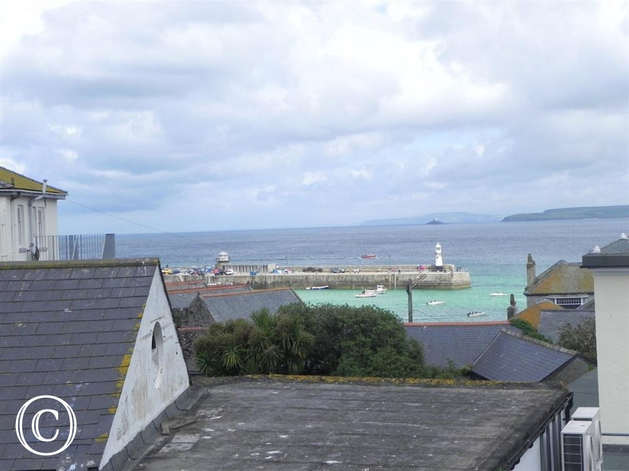Views of St Ives Harbour over the rooftops