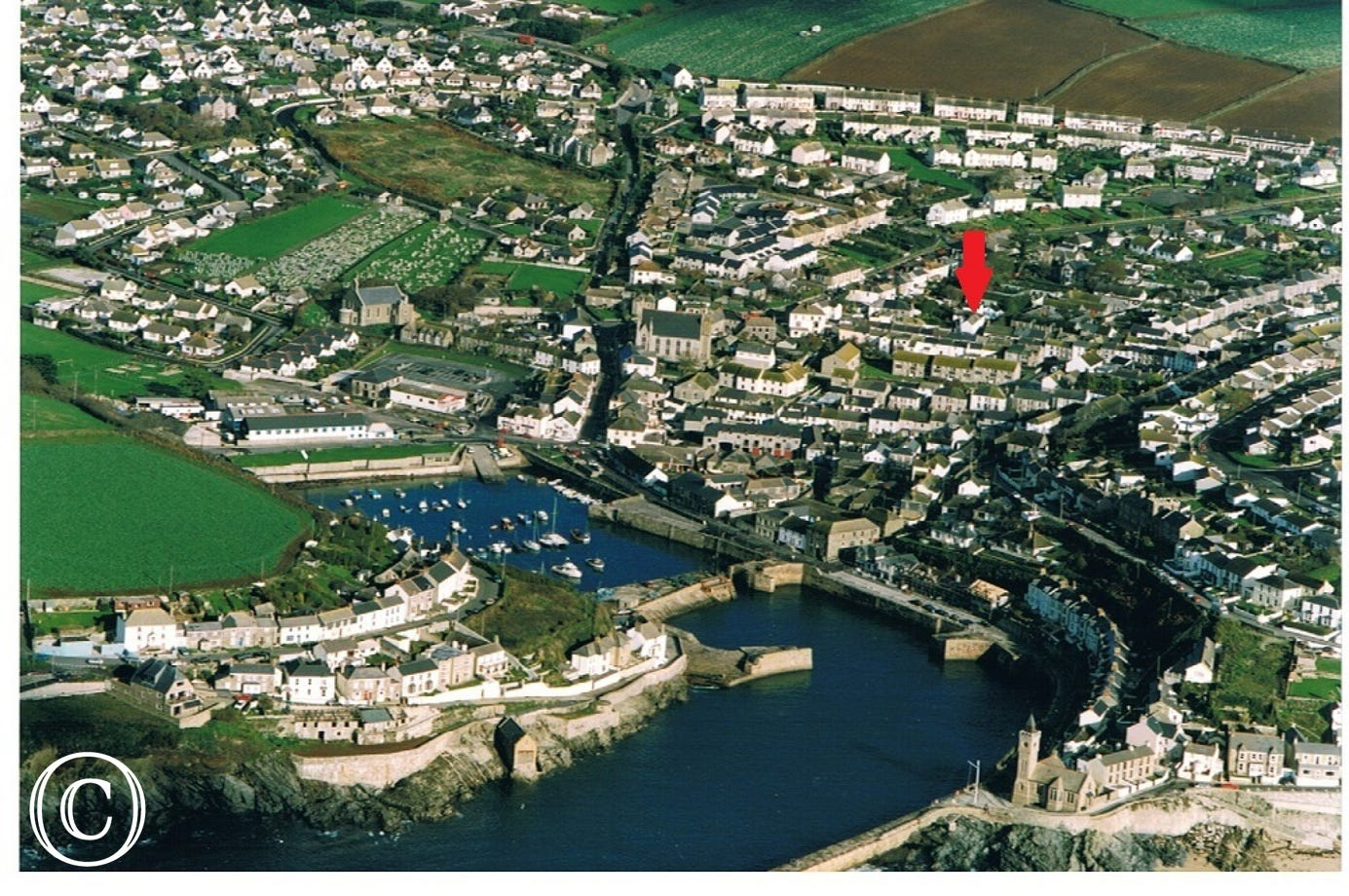 Aerial view of Porthleven showing Forth Scol location