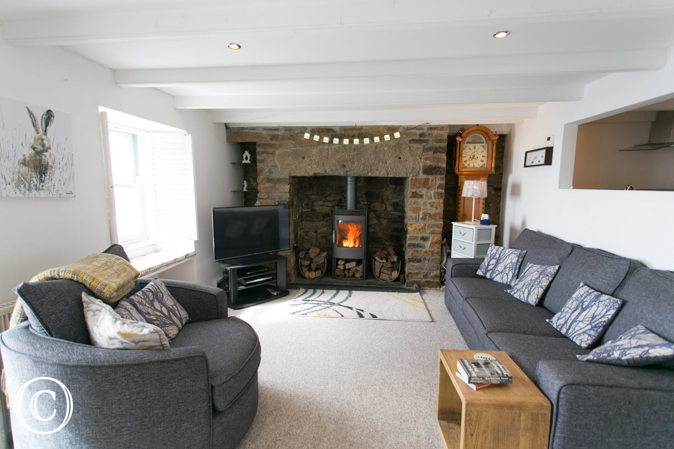 Samphire Cottage lounge with woodburner