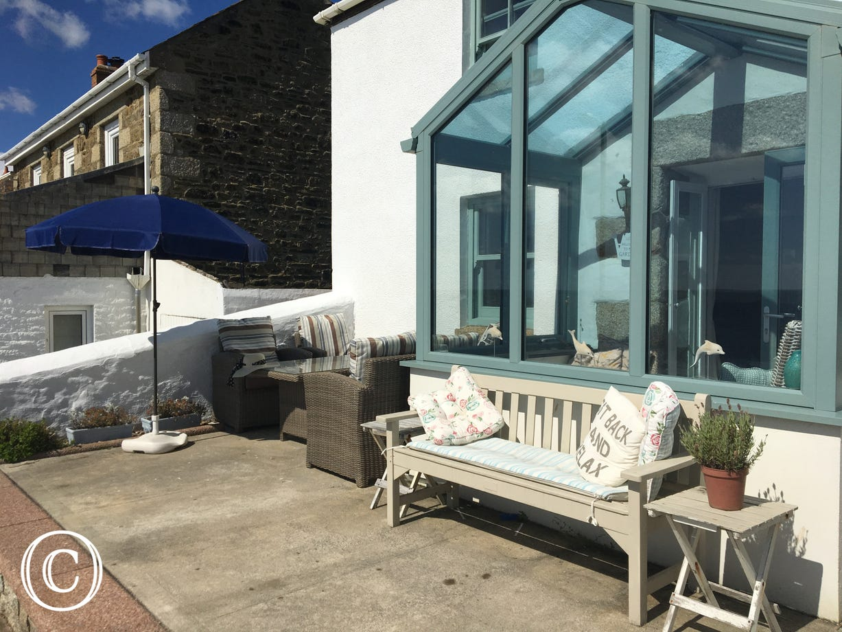 Samphire Cottage front patio seating