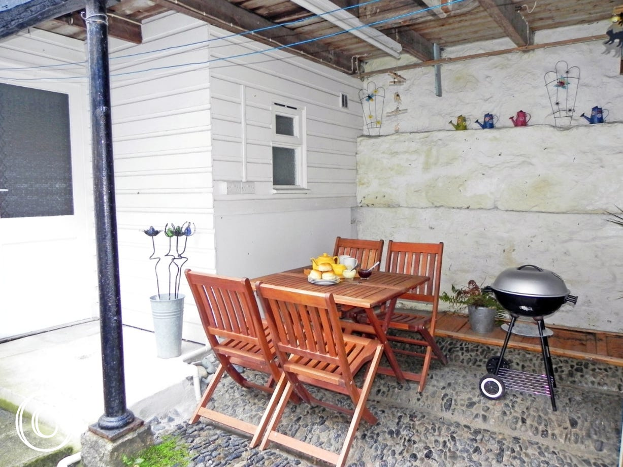 Yard with patio furniture and barbecue