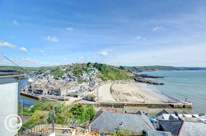View from the cottage right across Looe Beach and harbour
