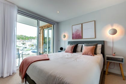 Master Bedroom with doors to balcony and views to river