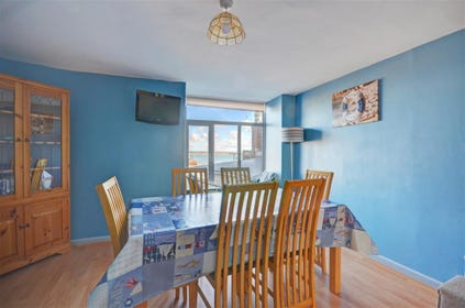 Large dining area with harbour views and colour tv