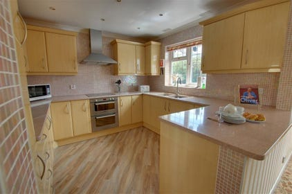 Stunning hand built kitchen with sparkly pink granite worktops